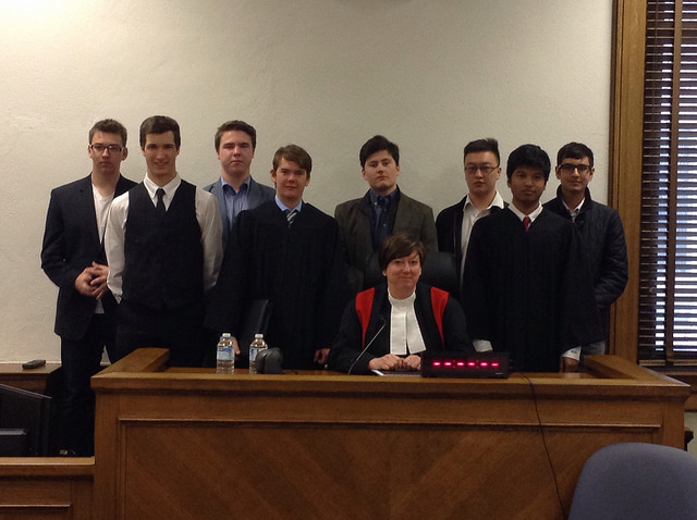 The Crown, Defence, and witnesses pose with the Judge in a bizarre moment of solidarity.