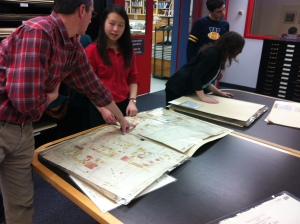 At the Archives of Manitoba reviewing a fire atlas.